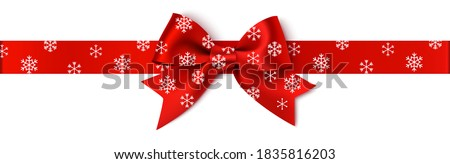 Decorative Christmas red bow with horizontal red ribbon. Vector New Year bow with snowflakes isolated on white background. Xmas decoration