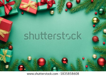 Merry Christmas and Happy New Year frame on turquoise background. Top view, flat lay with copy space for text Royalty-Free Stock Photo #1835858608