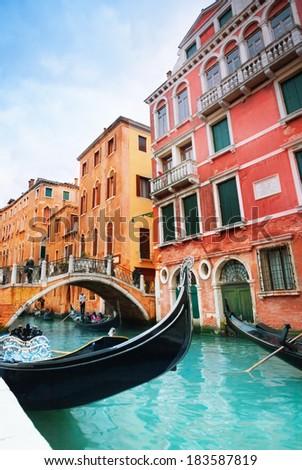 Gondola docks near Calle Zancani street and small canal with bridge in Venice, Italy #183587819