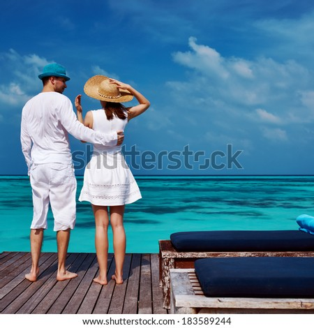 Couple on a tropical beach jetty at Maldives #183589244