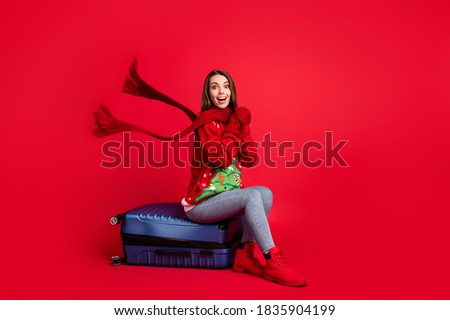 Full length body size view of her she nice attractive cheerful girl traveler, sitting on valise departing season destination resort flight tour isolated bright vivid shine vibrant red color background Royalty-Free Stock Photo #1835904199