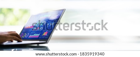 African American Data Analyst Using Data Analytics KPI Dashboard Royalty-Free Stock Photo #1835919340