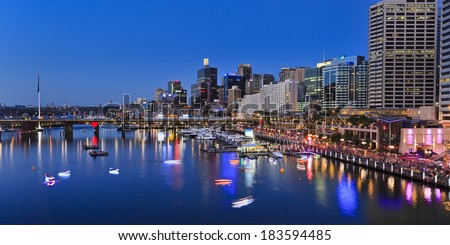 Australia sydney Darling Harbour sunset panorama vividly illuminated city landmarks with reflection in harbour water Royalty-Free Stock Photo #183594485