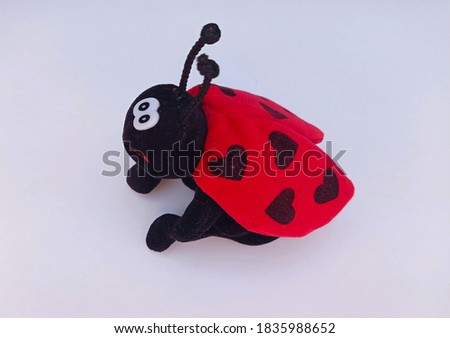 Photo of cute ladybug toy. Picture of ladybug with black and red colors.