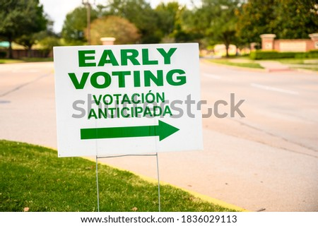 A sign directs residents to an early voting polling location for the 2020 Presidential election in Houston suburb, Texas