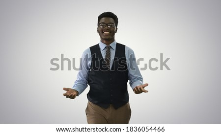 Young African american businessman gesturing and talking to came Royalty-Free Stock Photo #1836054466