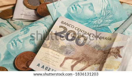 Real currency, money from Brazil. Dinheiro, Reais, Real Brasileiro, Brasil. A Brazilian banknotes in close up. #1836131203