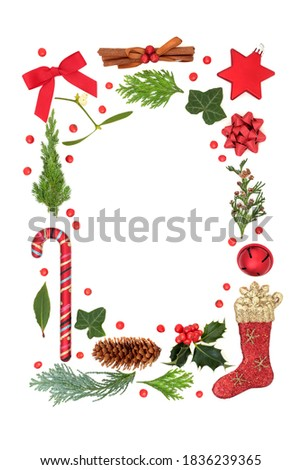 Christmas festive border with red bauble decorations, stars, holly & winter greenery with loose berries on white background. Abstract Xmas composition. Flat lay, top view, copy space. #1836239365