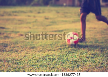 Young people playing football on the ground.Soccer goal moment.Copyspace media.