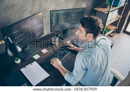 Top above high angle view portrait of his he nice attractive focused skilled geek guy typing bug track report cyberspace security at modern industrial interior style concrete wall work place station Royalty-Free Stock Photo #1836307909