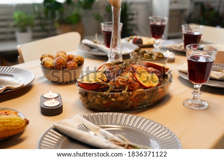 Background image of delicious roasted chicken at Thanksgiving table ready for dinner party with friends and family Royalty-Free Stock Photo #1836371122