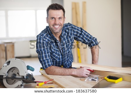 Smiling construction worker at work  #183637580