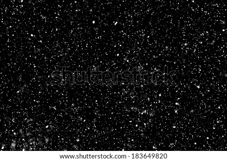 """Real falling snow on a black background for use as a texture layer in your project.  Add as """"Lighten"""" Layer in Photoshop to add falling snow to any image.  Adjust opacity to taste."""