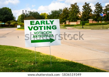 A sign directs residents to an early voting polling location for the 2020 Presidential election in Fort Bent County, Texas