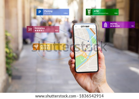 Conceptual photo showing augmented reality technology being used for navigation and location based apps.