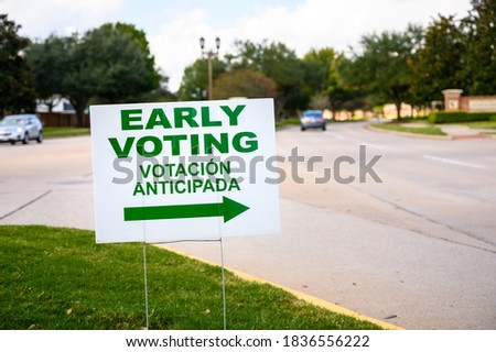 A sign directs residents to an early voting polling location for the 2020 Presidential election.