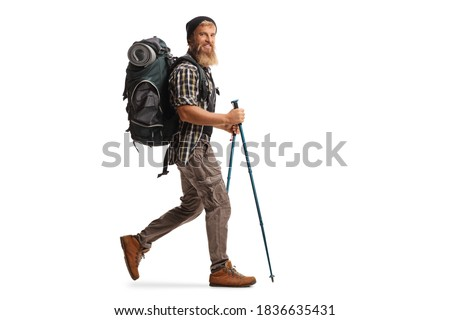 Full length profile shot of a bearded guy hiker with a backpack and hiking poles walking isolated on white background Royalty-Free Stock Photo #1836635431