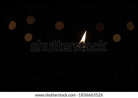 A picture that symbolizes the last hope in the dark cold night. Torch with a flame.