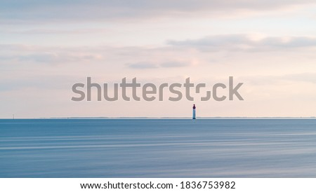 Beautiful minimalist seascape at sunset with Chauveau lighthouse. Rivedoux, Re Island, France Royalty-Free Stock Photo #1836753982