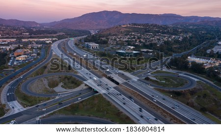 Twilight aerial view of the 91 Freeway through the community of Anaheim Hills in Anaheim, California, USA. Royalty-Free Stock Photo #1836804814