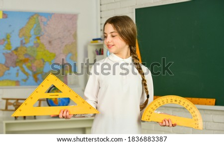 different school elements. stationery in autumn school time. Back to school. education in college. mired in geometry. School girl protractor and triangle. Instrument of Measurement.