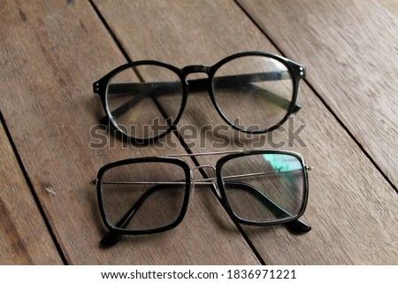 two modern and stylish glasses on a wooden background. #1836971221