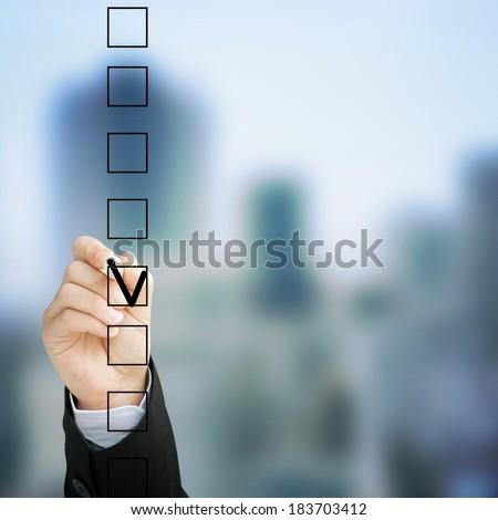 Hand choosing one of three options  #183703412