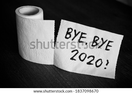 Conceptual image of toilet paper, symbol of covid-19 crisis and pandemia in 2020. Abstract image, saying goodbye to the bad year, leaving the past behind, hoping for better. Royalty-Free Stock Photo #1837098670