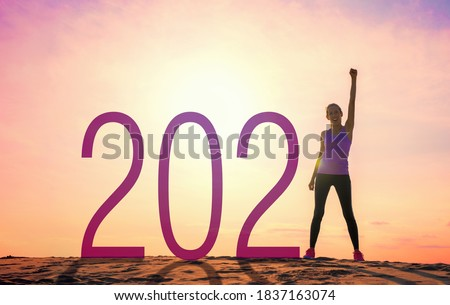 Woman ready for fresh start and resolutions for accomplishing new goals #1837163074