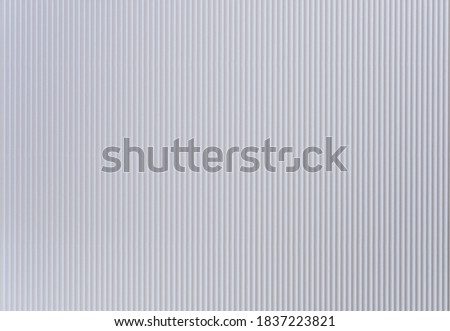 Backgrounds and textures: paper corrugated background. Light gray, vertical stripe. Kyiv (Kiev), Ukraine, Europe.