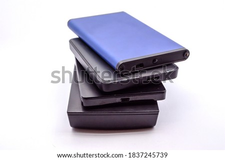 HDD - Stack of Portable Hard Disk Drives isolated on white background. Pile of External hard disk drives.