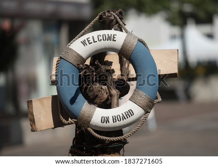 a safety buoy or life buoy for rescuing people at the beach Royalty-Free Stock Photo #1837271605