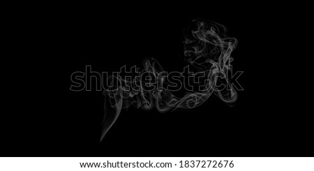 Abstract white puffs of smoke swirls overlay on black background pollution. Royalty high-quality free stock photo image of abstract smoke overlays on black background. White smoke swirl fragments