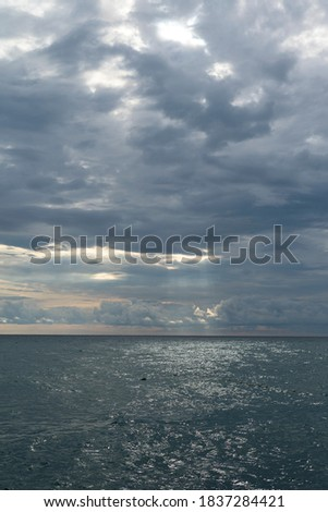 Beautiful background with sunset on the black sea. Cloudy sky and waves. Sochi, Russia, September 29, 2019 Royalty-Free Stock Photo #1837284421