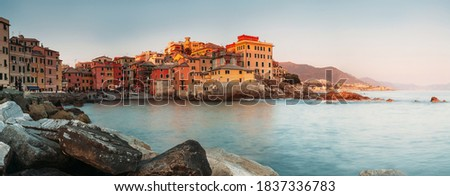 Sunset in Boccadasse bay, Italy, Genoa panorama image. Travel in Europe concept image. Royalty-Free Stock Photo #1837336783