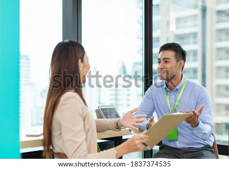 Asian businessman and businesswoman explaining work with paper chart and digital tablet. Group of Asian businesspeople talking ideas new project in the modern office. businesspeople and office concept Royalty-Free Stock Photo #1837374535