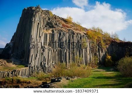 Rock formation natural monument Basalt organ. Polygonal structures of basalt columnar separation in Panska skala near Kamenicky Senov, northern Bohemia, Czech Republic. October 21, 2018 Royalty-Free Stock Photo #1837409371