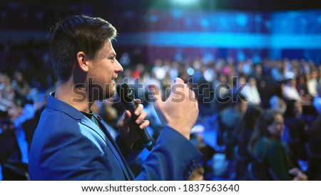 Viewer crowded audience speak with speaker in microphone. Participant forum speaking. Educational speech business man. Speaker group auditorium people. Presenter talk. Education conference spectator. Royalty-Free Stock Photo #1837563640
