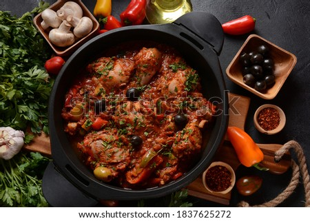 Chicken cacciatore with bell peppers, tomatoes, black olives. Italian food Royalty-Free Stock Photo #1837625272