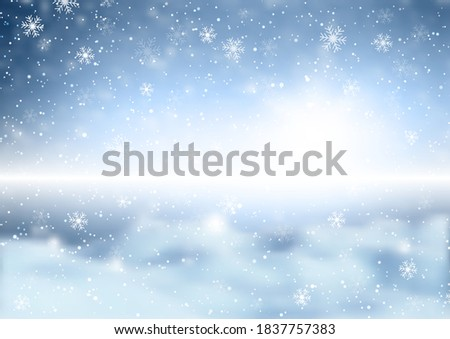 Christmas snowflakes on a defocussed winter landscape background #1837757383