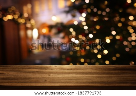 Empty table in front of christmas tree with decorations background. For product display montage #1837791793
