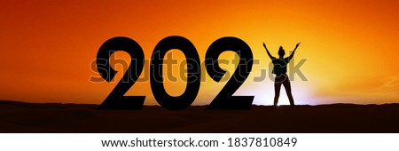 2021, silhouette of a woman standing in the sunset, women empowerment, feminist new year holiday panoramic web banner Royalty-Free Stock Photo #1837810849