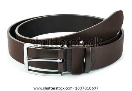 Fastened fashionable men's leather belt with dark matted metal buckle isolated on white background. Royalty-Free Stock Photo #1837818697