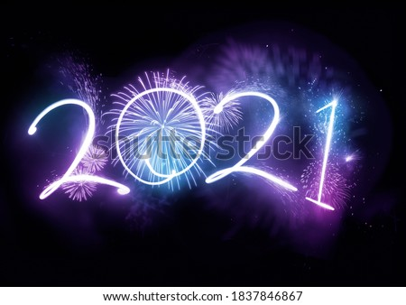 Welcoming the year 2021 displayed with fireworks and strobe lights. New year celebration concept. #1837846867