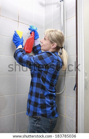 woman cleaning an old dirty bathroom #183785036