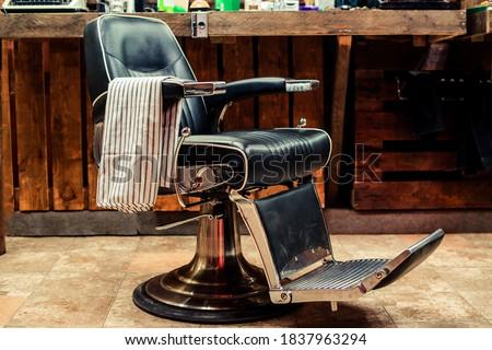 Vintage barber chair. Barbershop business. Barber shop chair. Modern hairdresser and hair salon. Barber shop for men. Barbershop theme. Barbershop interior. Stylish vintage barber chair. #1837963294