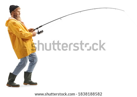 Full length profile shot of a young bearded fisherman catching with a fishing pole isolated on white background Royalty-Free Stock Photo #1838188582