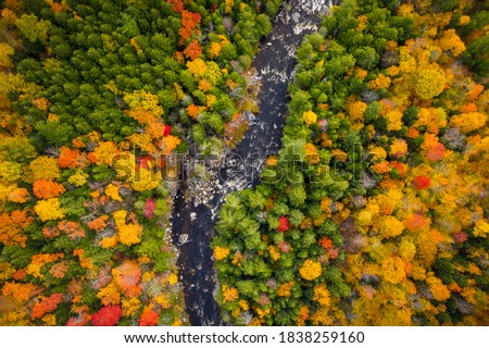 Aerial view of Winding River Through Autumn Trees with Fall Colors in Adirondacks, New York, New England Royalty-Free Stock Photo #1838259160