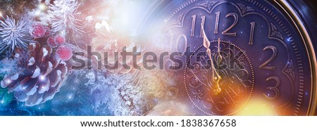 New Year banner with clock. Neon lights, holiday lights. Time shows 12 o'clock, New Year and Christmas 2021. Winter holiday background. #1838367658