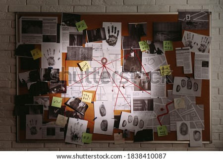 Detective board with fingerprints, photos, map and clues connected by red string on white brick wall #1838410087